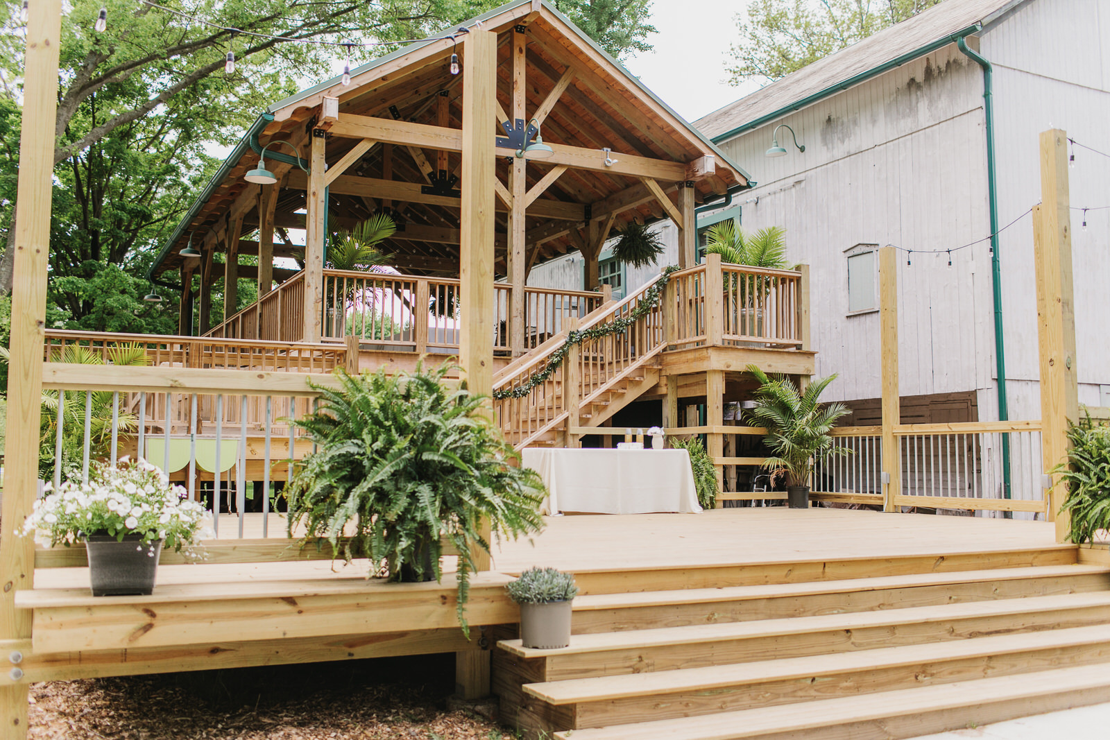 Covered Adjoining Deck - Perfect to take in the wooded views during cocktail hour, guest seating, set up your buffet or dance the night away! The covered deck also is a great option for an alternative ceremony site in case of rain.