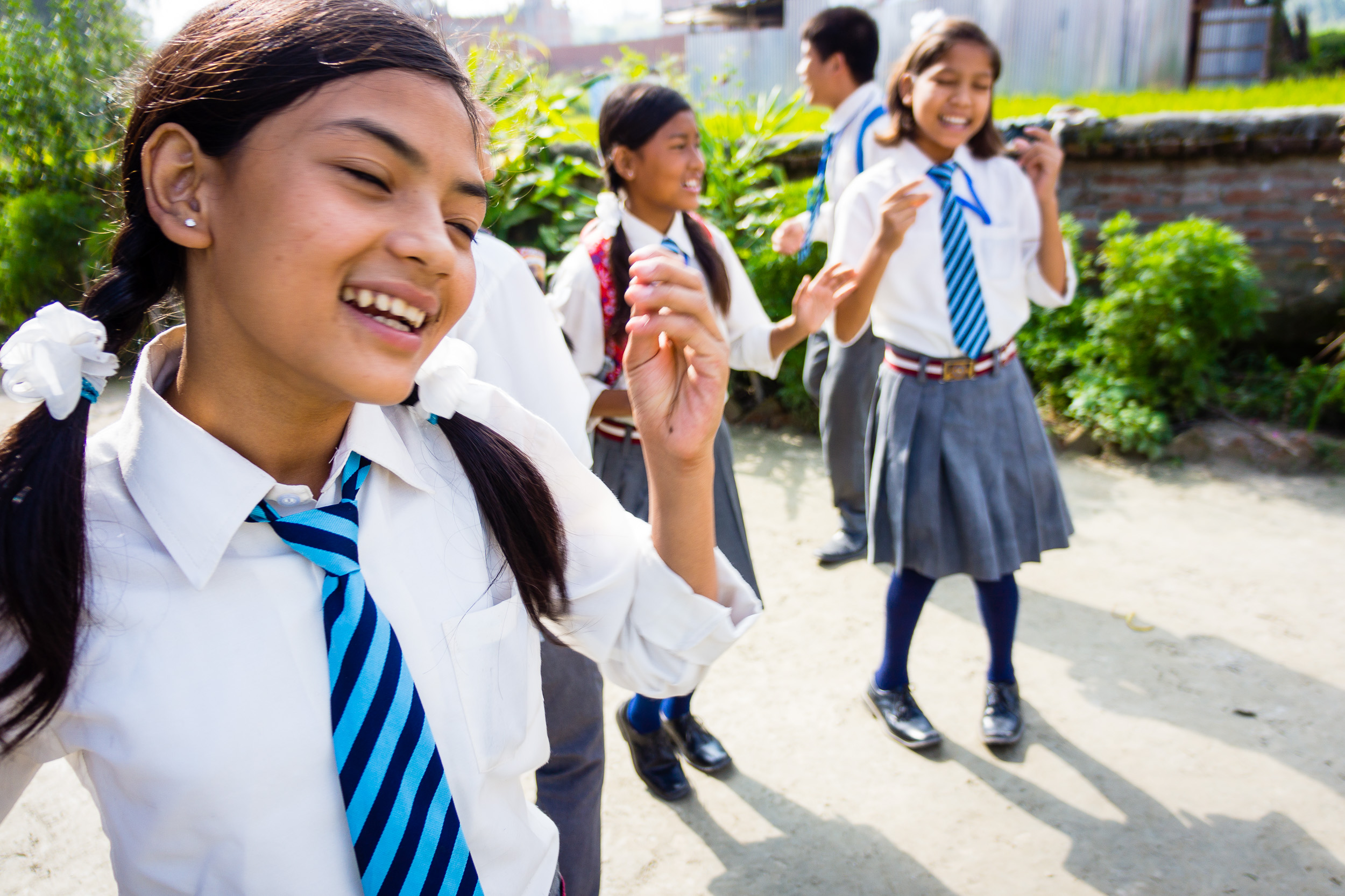 (Doing the Hokey Pokey) I have never seen kids more excited about going to   school. Bhaktapur