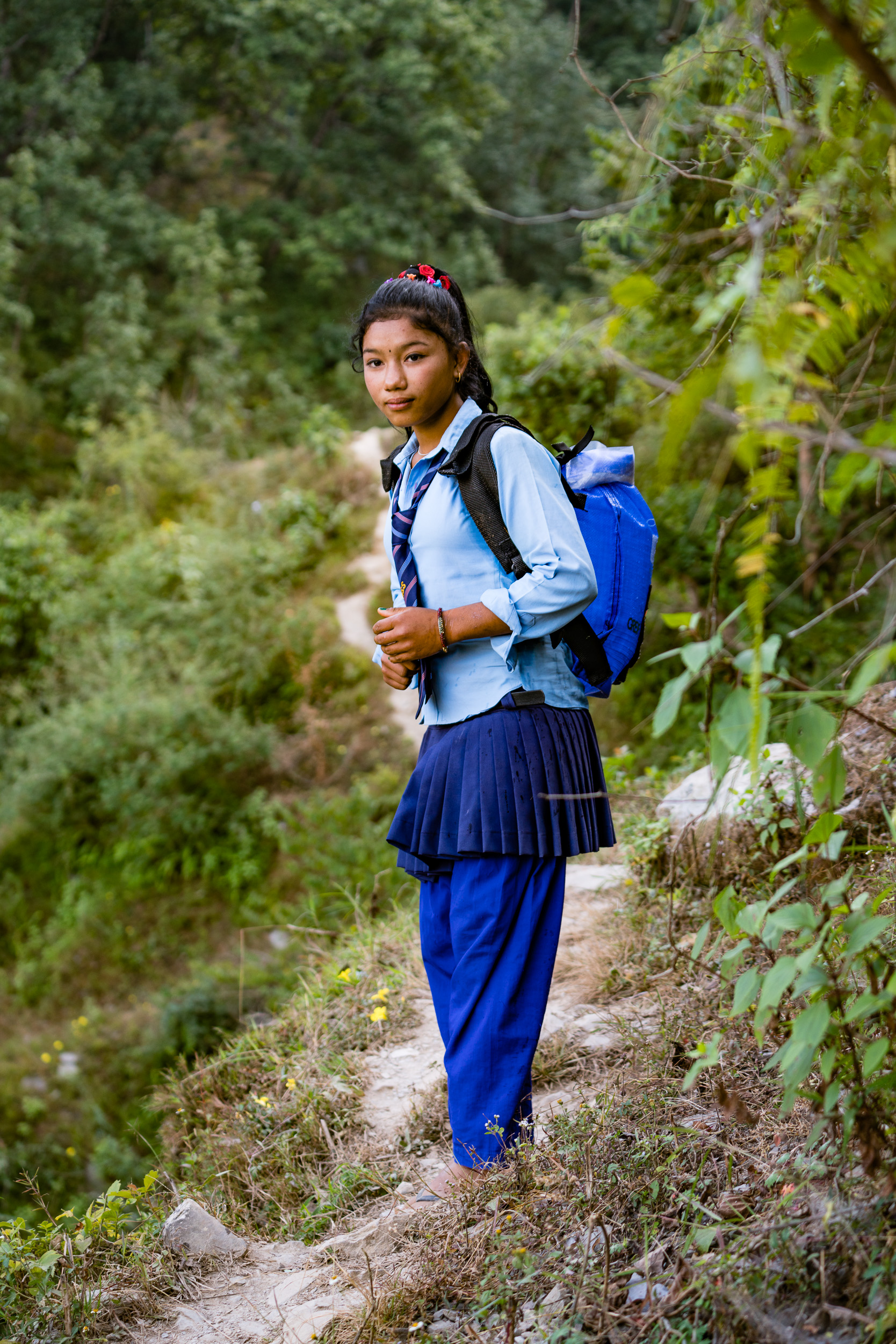 In small villages up in the mountains, one of the chores girls do is fetch water from a mountain spring. It is along a small, steep path cut into the mountainside. Literally hundreds of feet up. These backpacks designed to carry water provided by Kids of Kathmandu make the chore easier and safer.