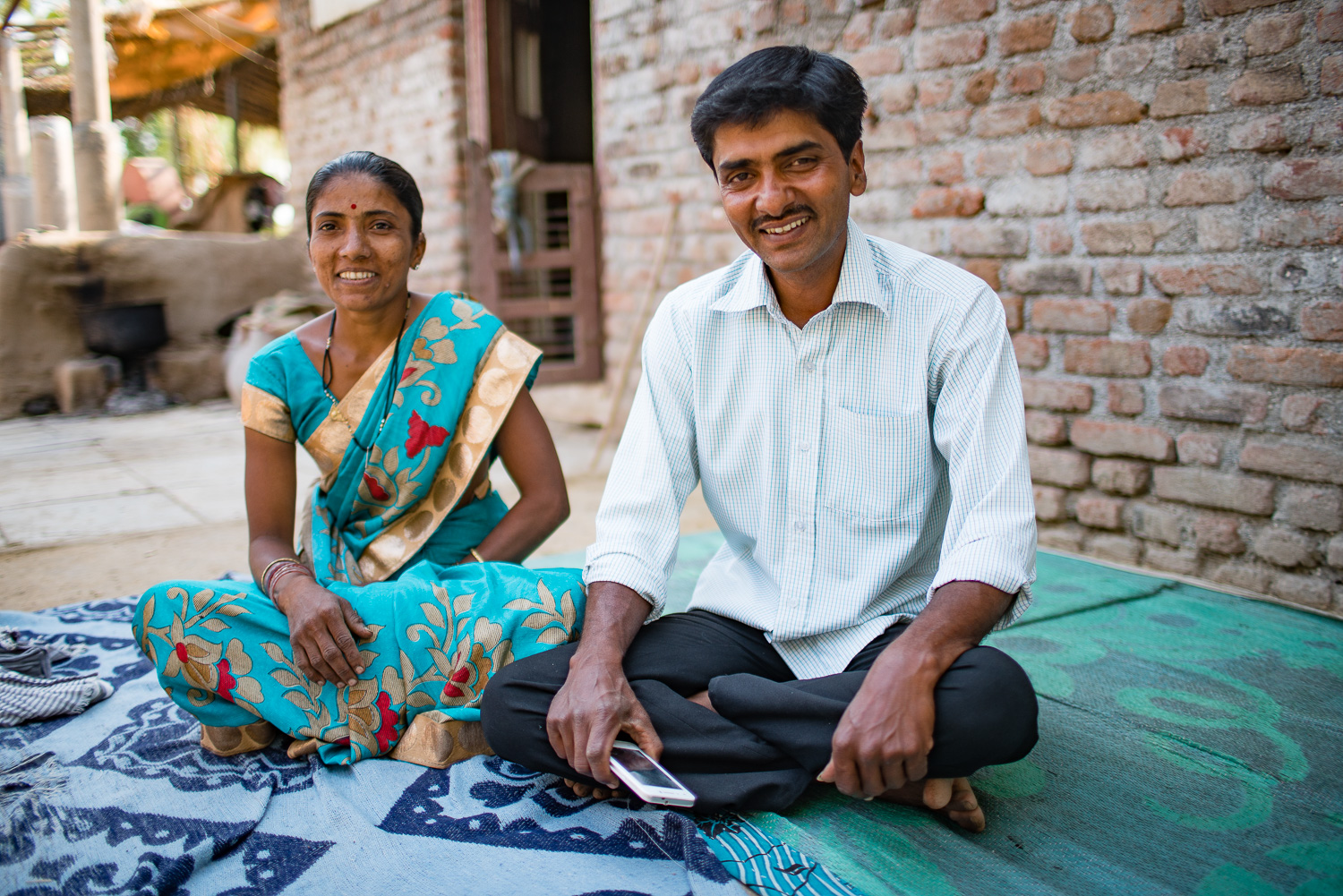 Husband and wife dairy farmers in India.