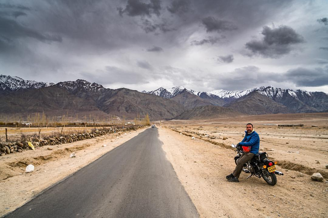 Riding the Himalayas on a Royal Enfield motorcycle. The bike is underpowered, heavy, and terrible brakes, but amazing to ride through the Himalayas. Always find time to do things that make you happy. Love what you do, and it will love you back!