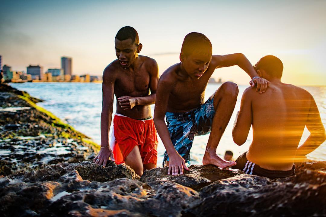 I spent a little time with these guys who were swimming at sunset off the Malecon in Havana, Cuba. Amazing light and always something different going on.