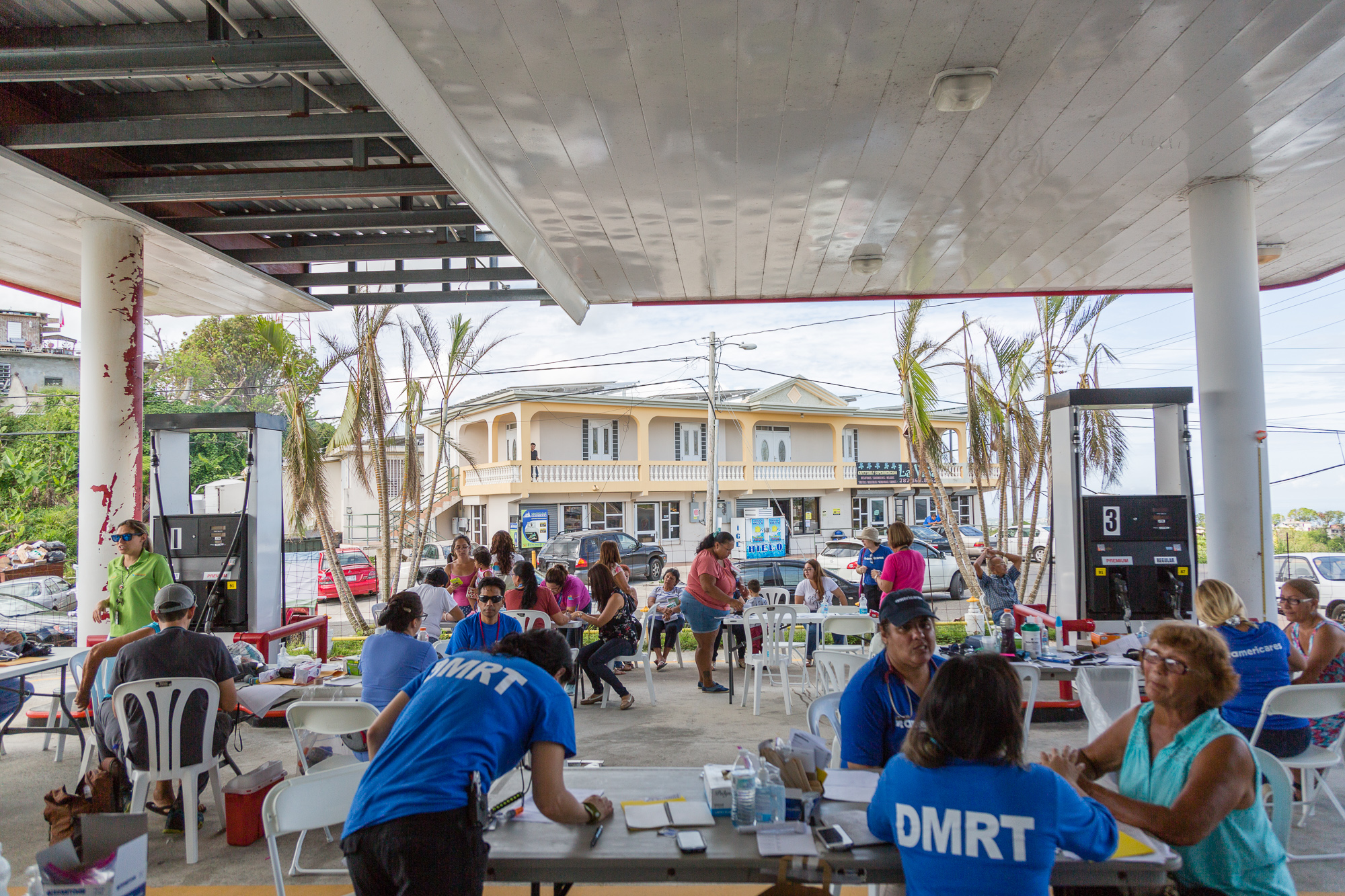 A temporary health clinic set up in a closed gas station damaged by hurricane Maria