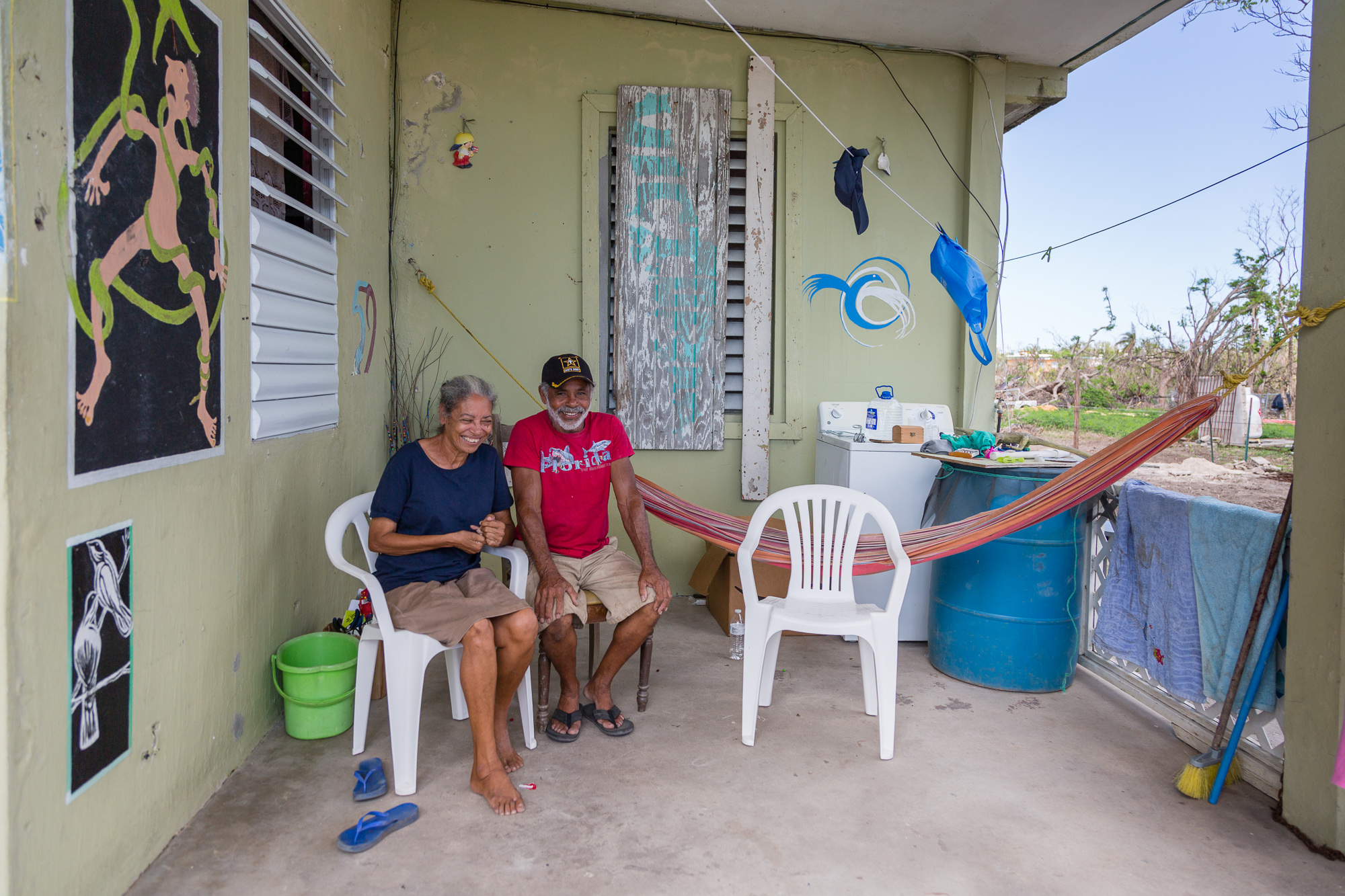 An artist and his wife rode out the storm at their waterfront home with the waves crashing at their door. Vieques, Puerto Rico.