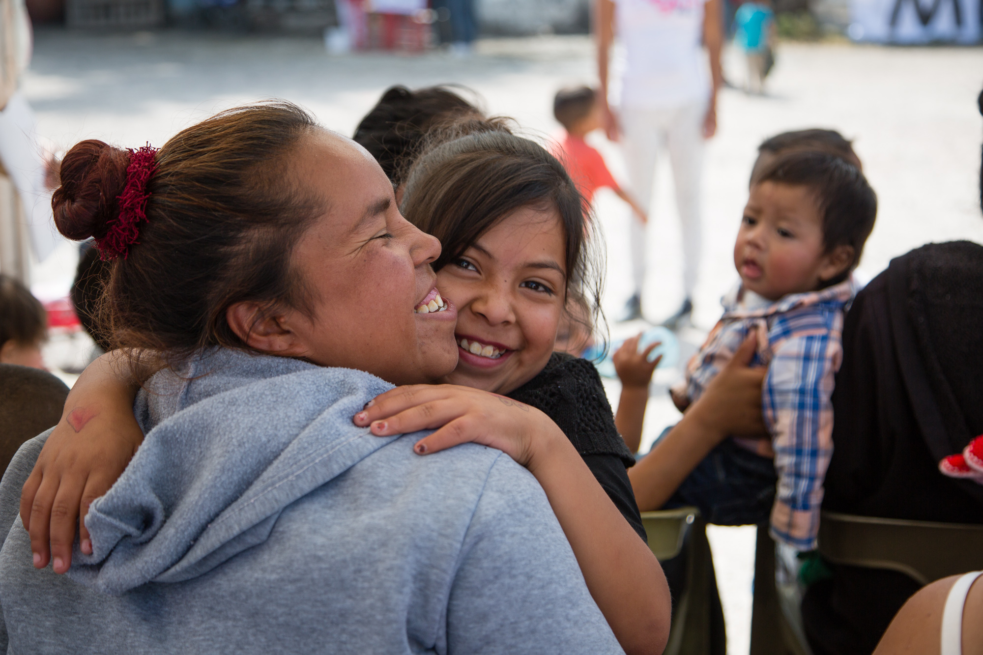 Mother and daughter waiting their turn at a temporary clinic outside of Mexico City.