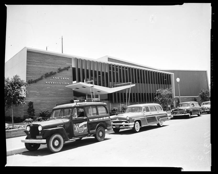 This is the outside view of the building taken on June 6th, 1954 during the opening of the Newport Balboa Savings and Loan Association. Source:  USC Digital Library
