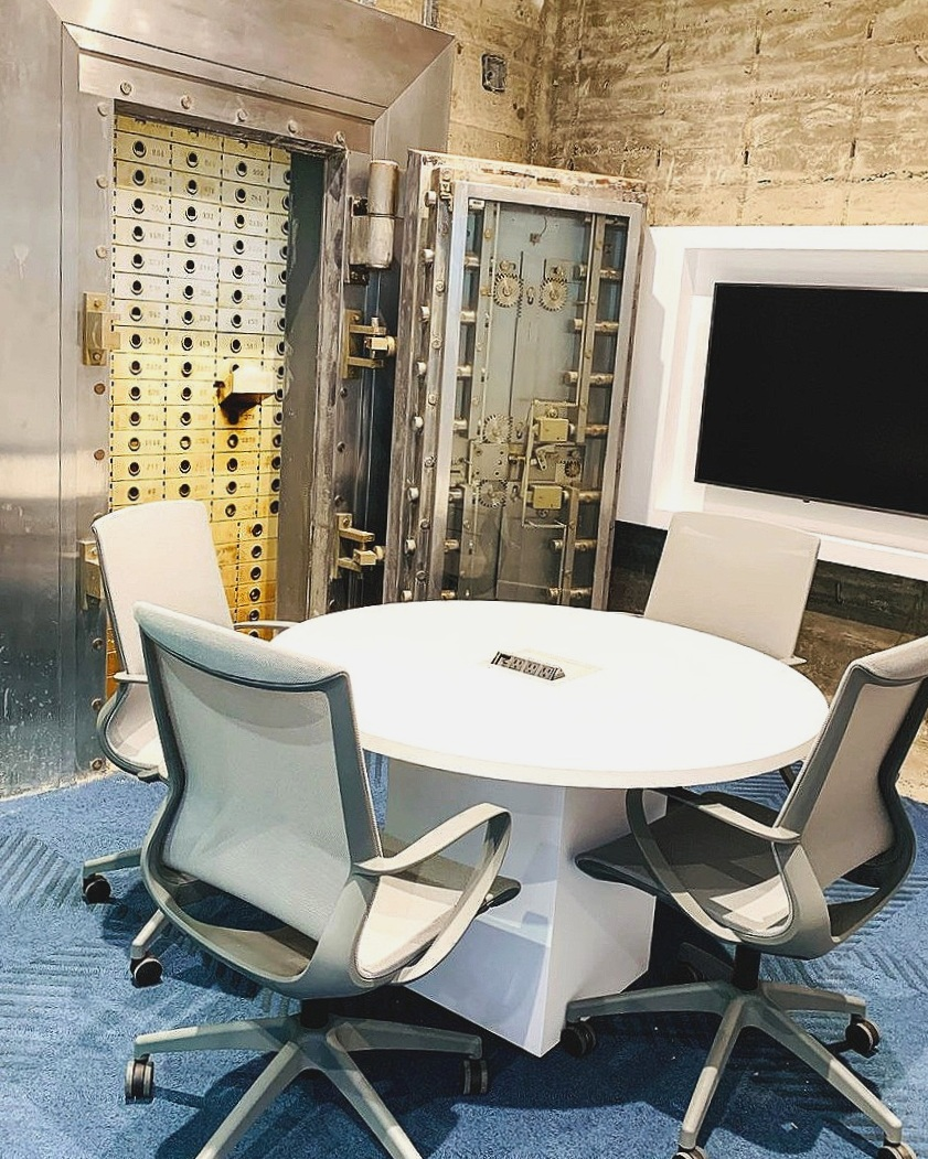 "The original vault door from 1954 was kept and serves as a white board within our conference room ""New York""."
