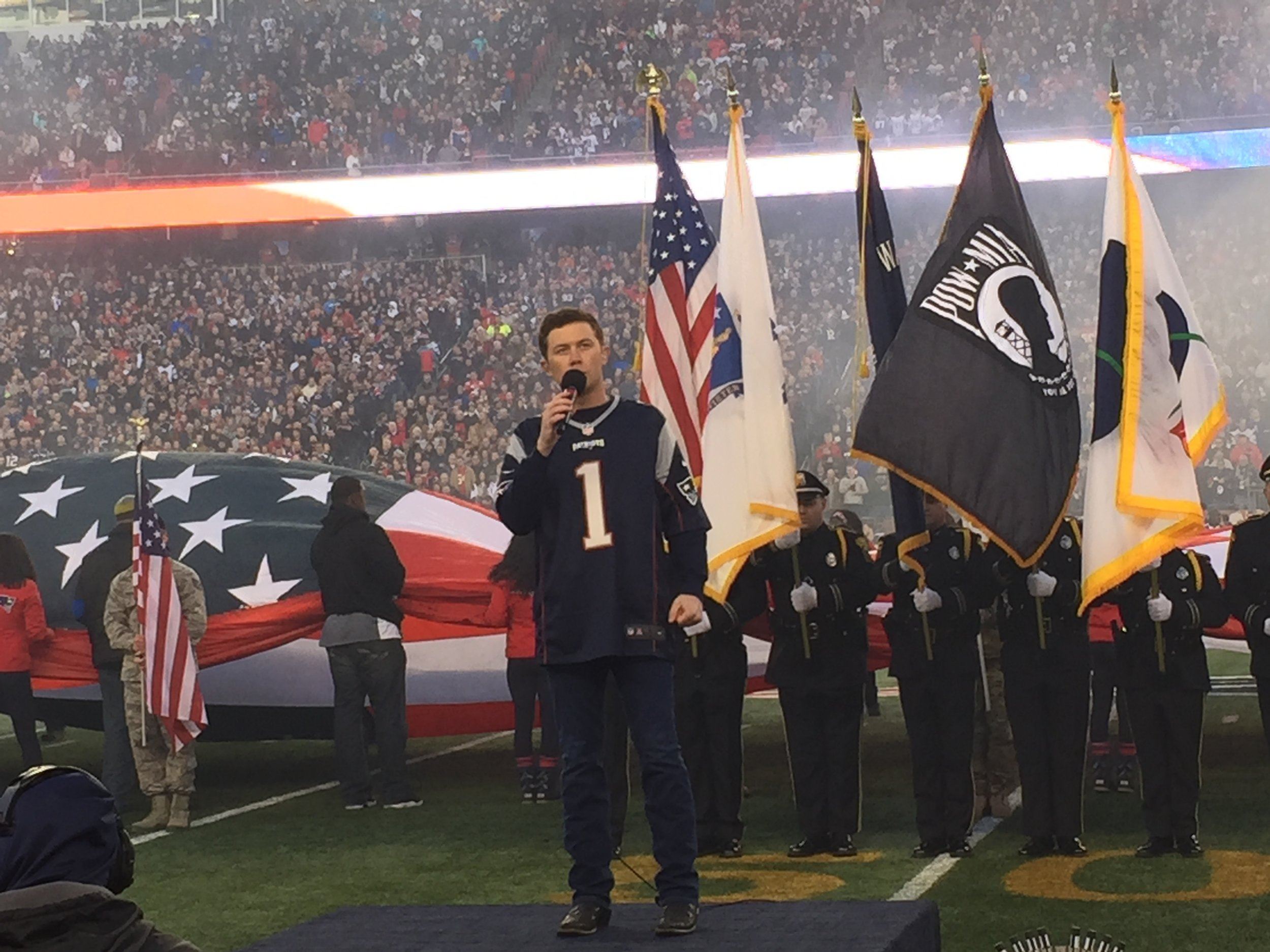 Scotty McCreery performing the National Anthem at Gillette Stadium in Foxboro, MA on Jan. 16, 2016 before the New England Patriots vs. Kansas City Chiefs game. (Photo Credit: Scott Stem)