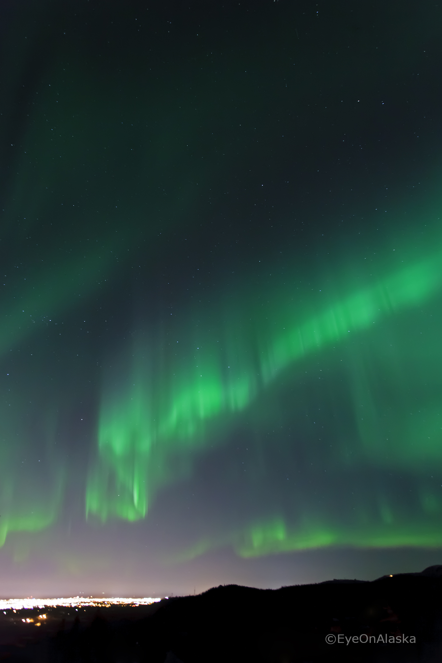 Aurora curtains over Anchorage.