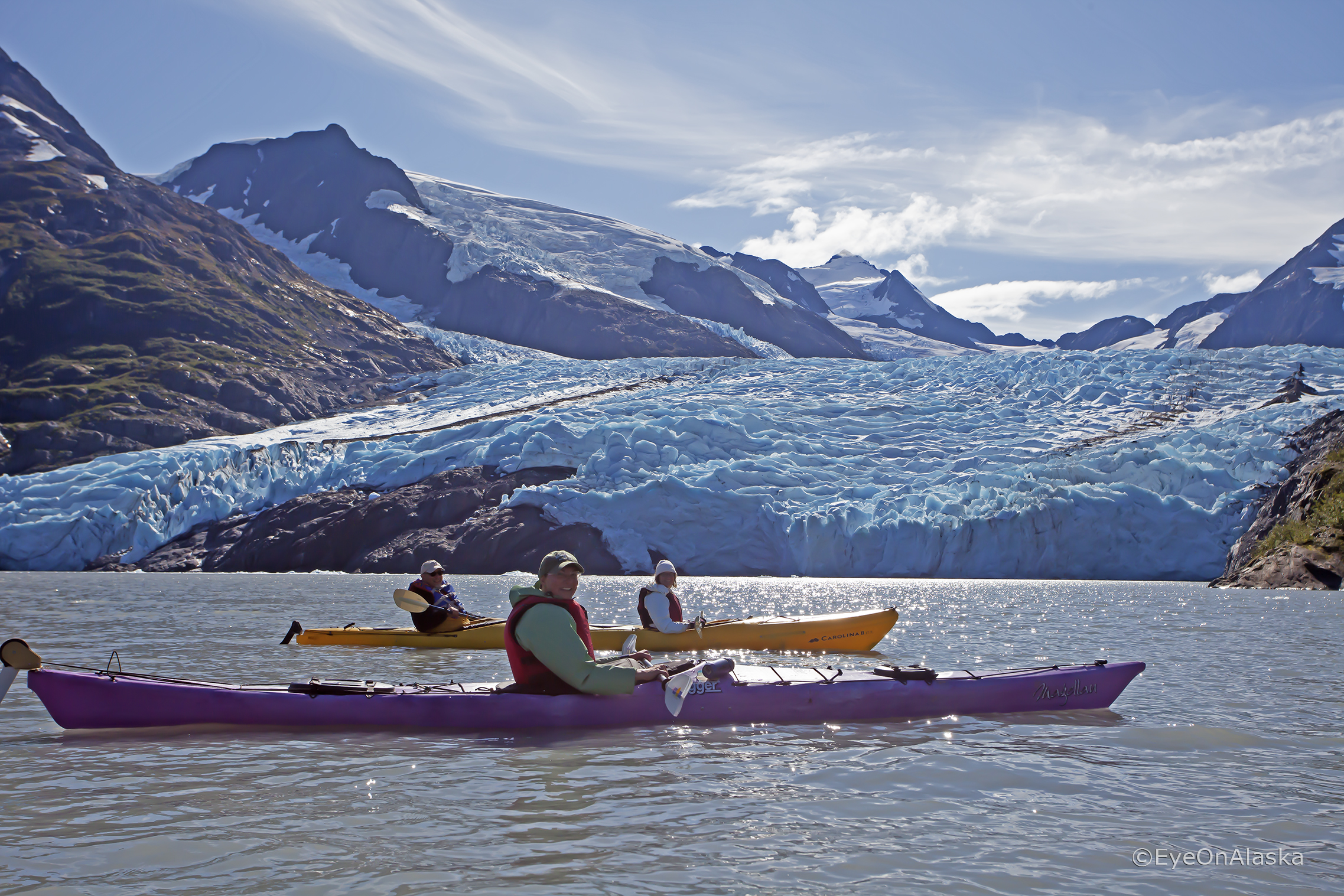 Kayaks in front of Portage Glacier.