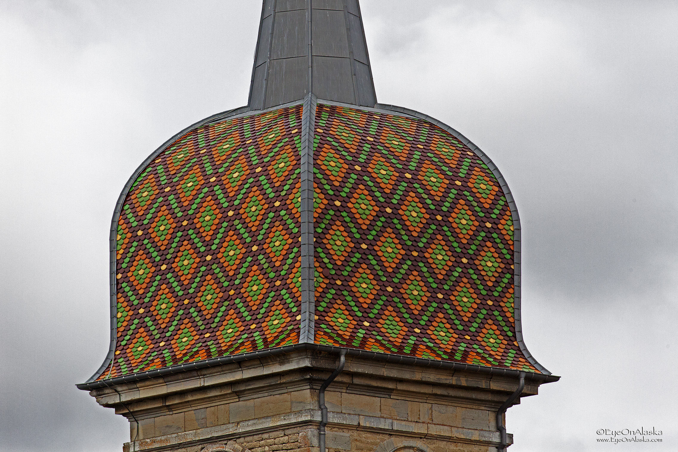 Close up of the varnished tile bell tower dome.