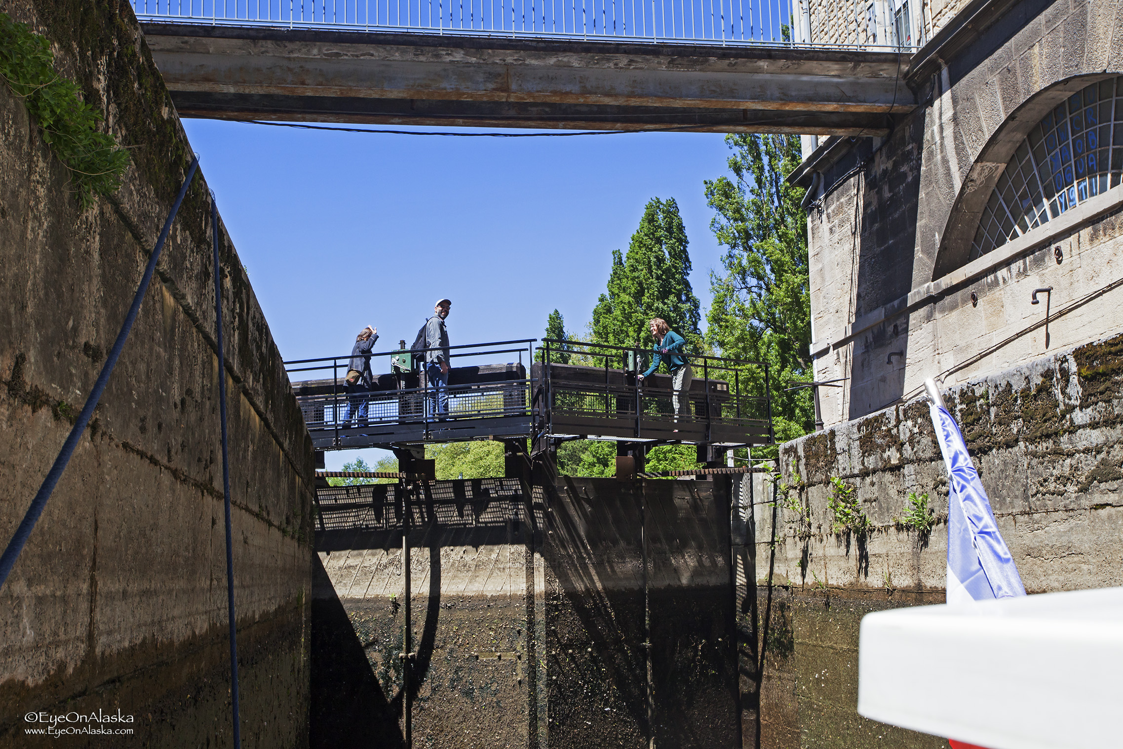 A couple of tourists helped Devany work the cranks to operate the lock. The new automated locks are much easier.