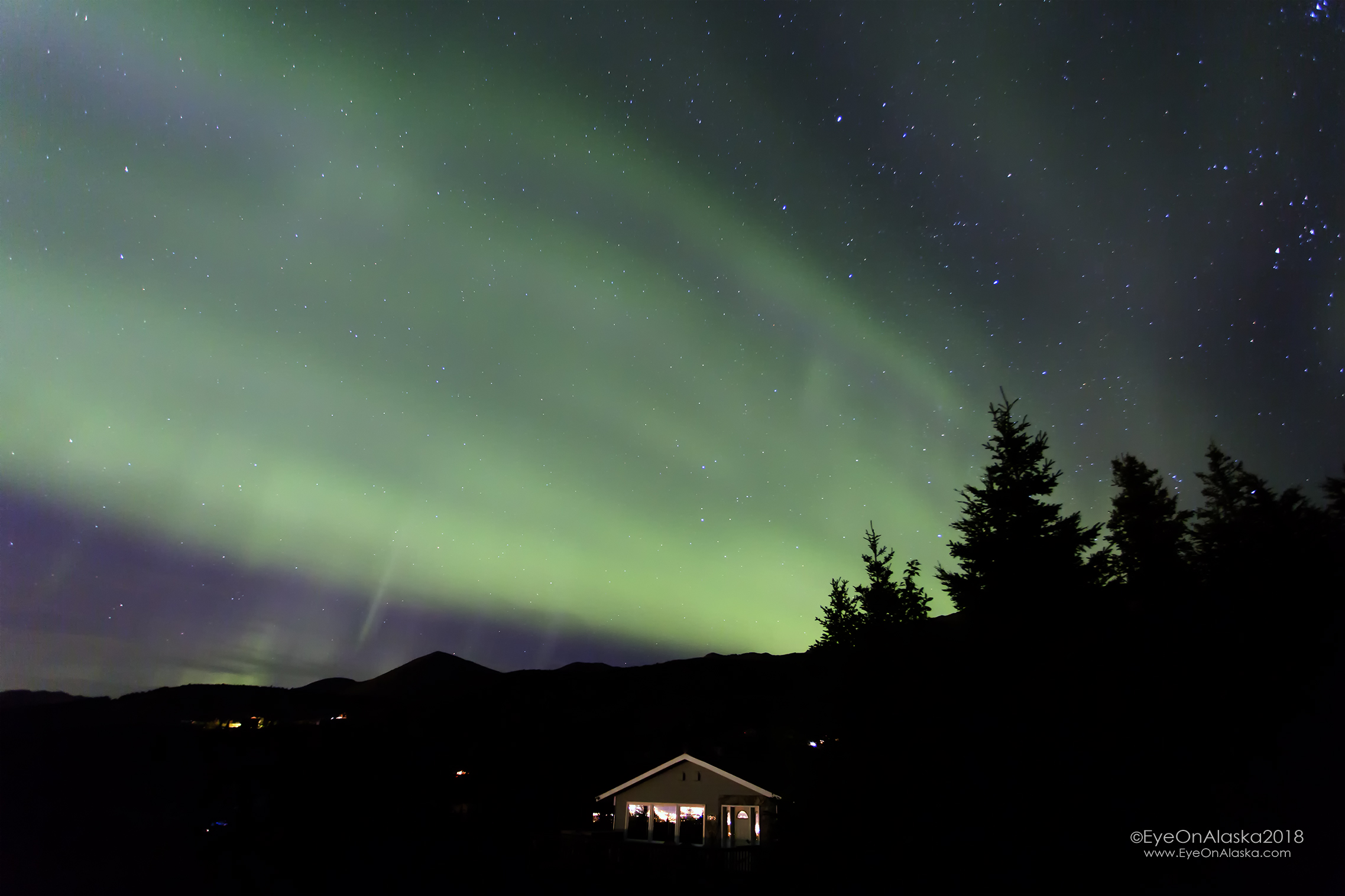 Aurora blanketing Bear Valley and our house.  I do admit I think the Aurora looks better when there's snow on the ground.