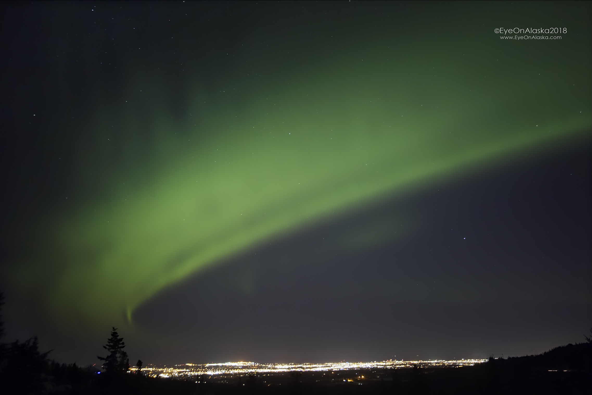 Downtown Anchorage blanketed by the Aurora.
