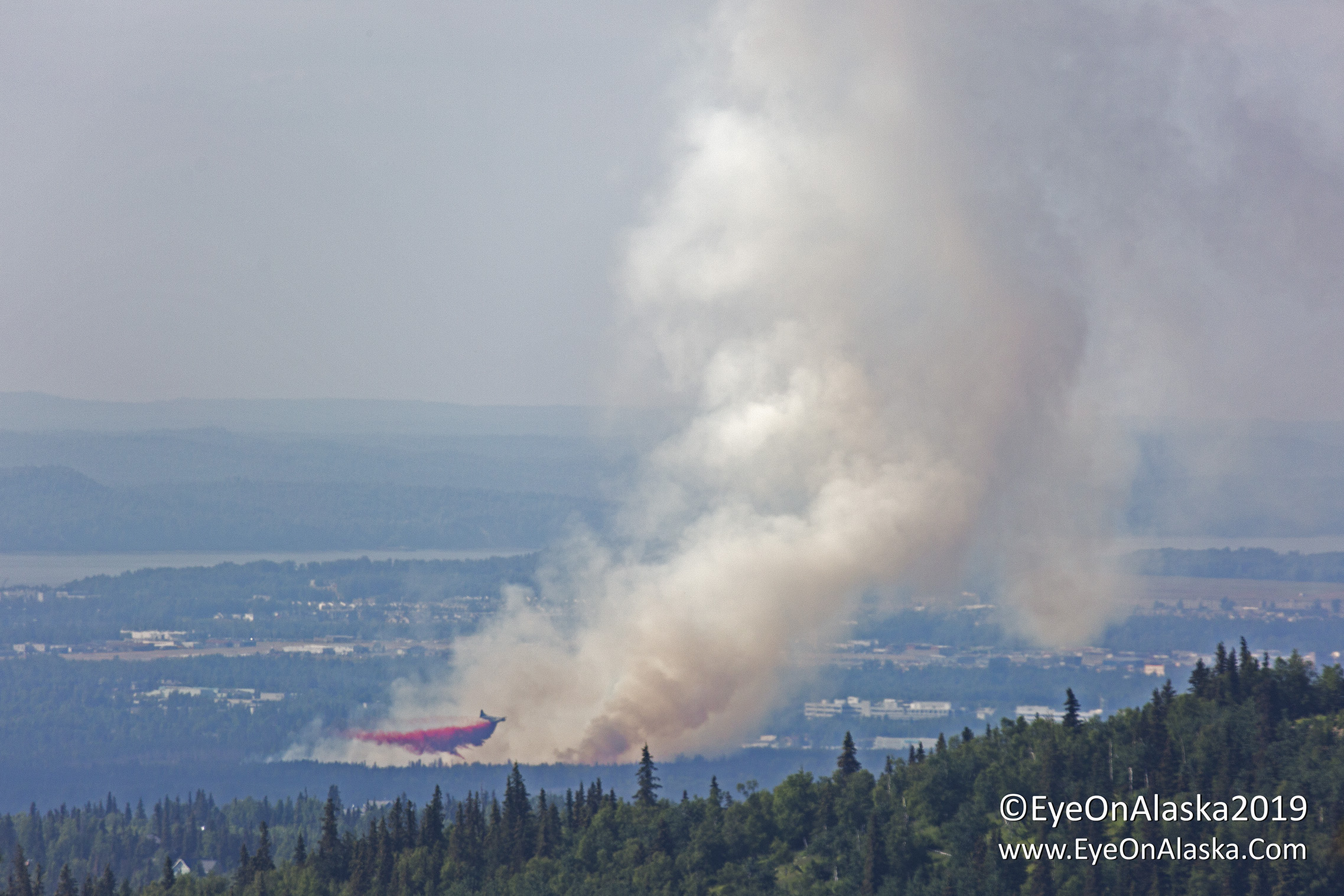 Retardant drop on the leading edge of the fire.