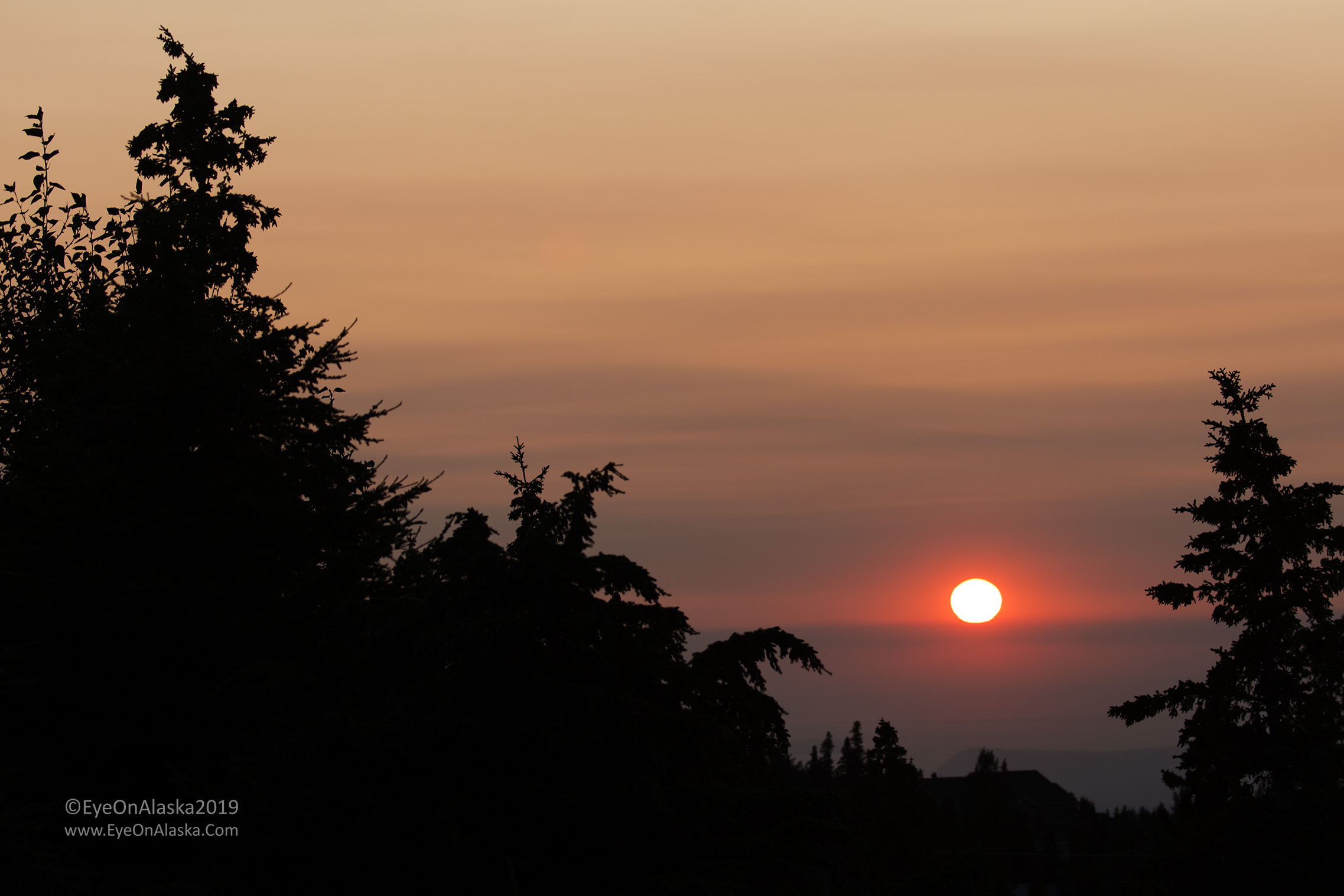 9:45pm and the sun sets through the wildfire smoke.