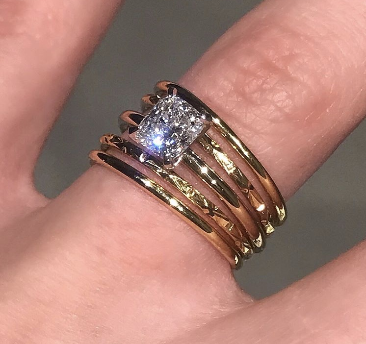 Custom-made 18ct Yellow Gold Stack of 5 Bridal Rings, showcasing one beautiful 0.80ct Cushion Brilliant diamond floating atop two smooth finish bands, and two hammered finish bands.