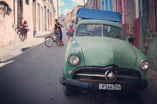 The street scene in Santiago de Cuba #travelpics #travelgram #travel #cuba #cars #classiccars #vintagecar #streetscene #santiagodecuba