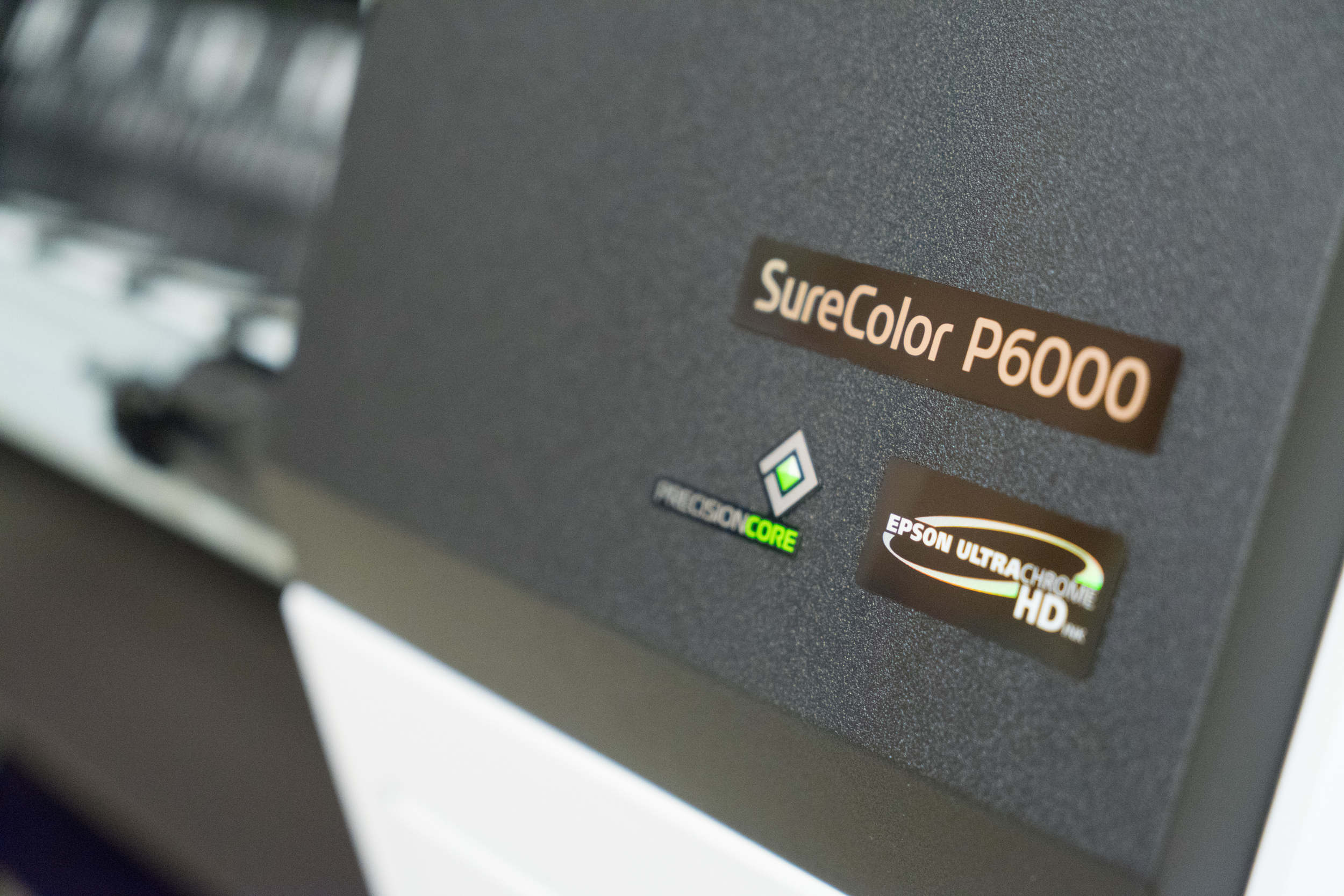 "Our large format printer by Epson, the SureColor P6000 capable of 24"" wide borderless printing using a color precise 9 ink system for beautiful gradations."