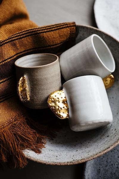 Ceramic cups with gold detail by  Bridget Bodenham