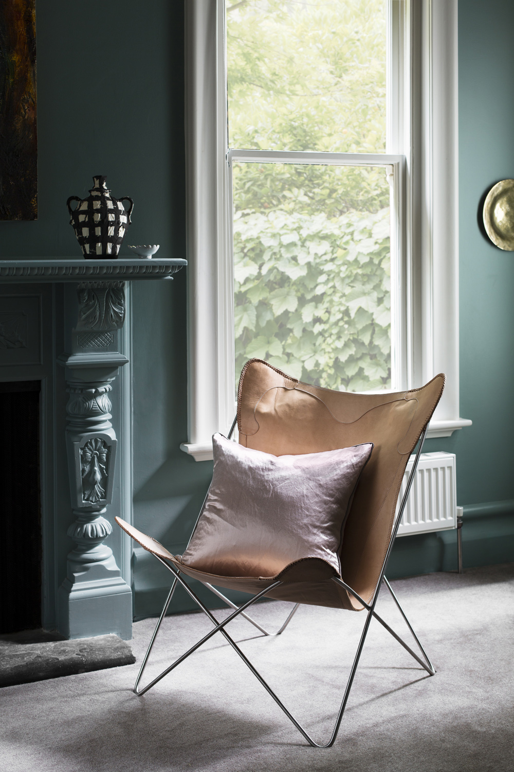 Cushion from  Le Marc  and Butterfly chair from  Barnaby Lane . Photography  Martina Gemmola .
