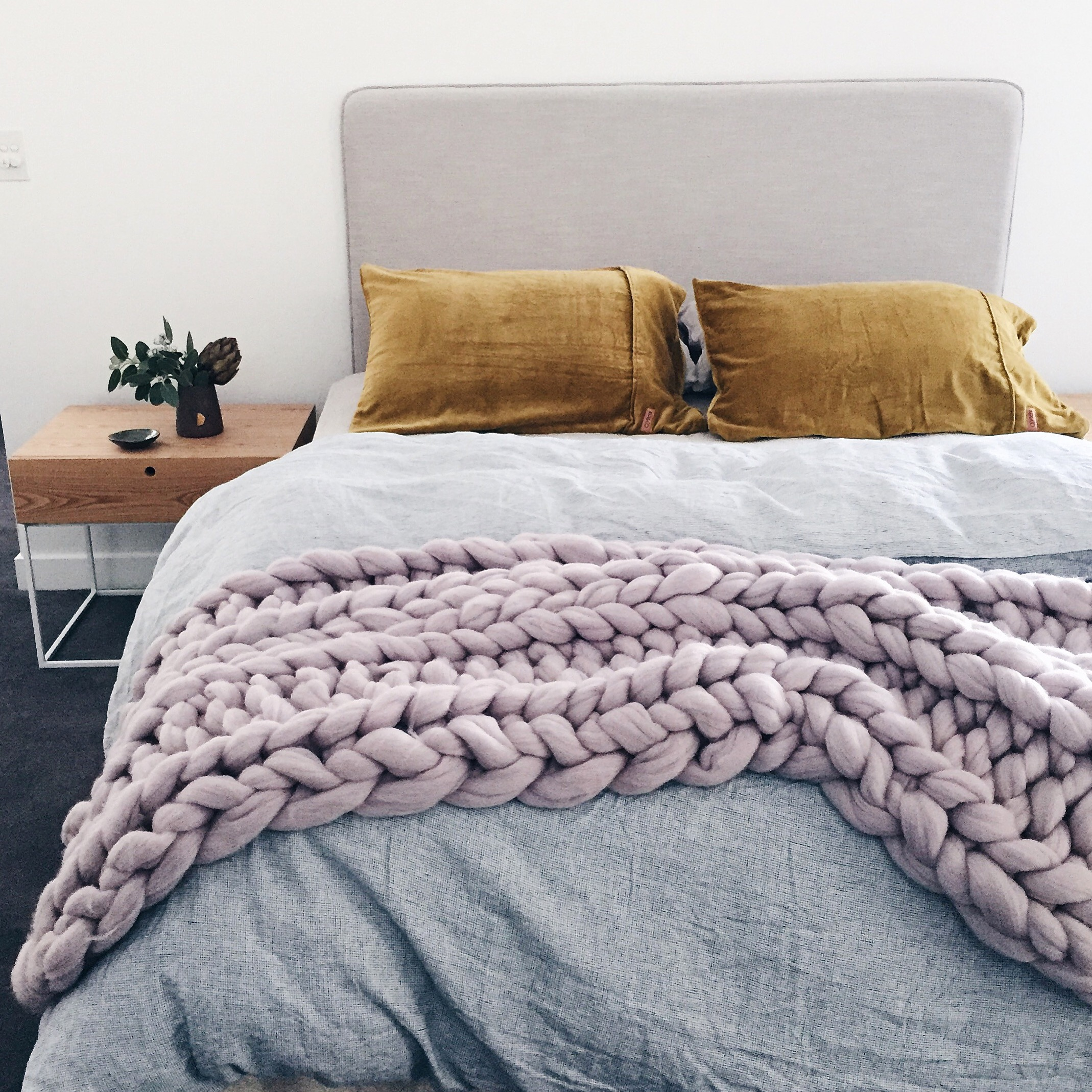 Fringed linen bedhead by  Grazia and Co,  Vintage washed linen doona cover  Adairs , velvet pillow slips  Kip and Co , chunky merino throw by  Closely Knit , bedside tables  Globe West.