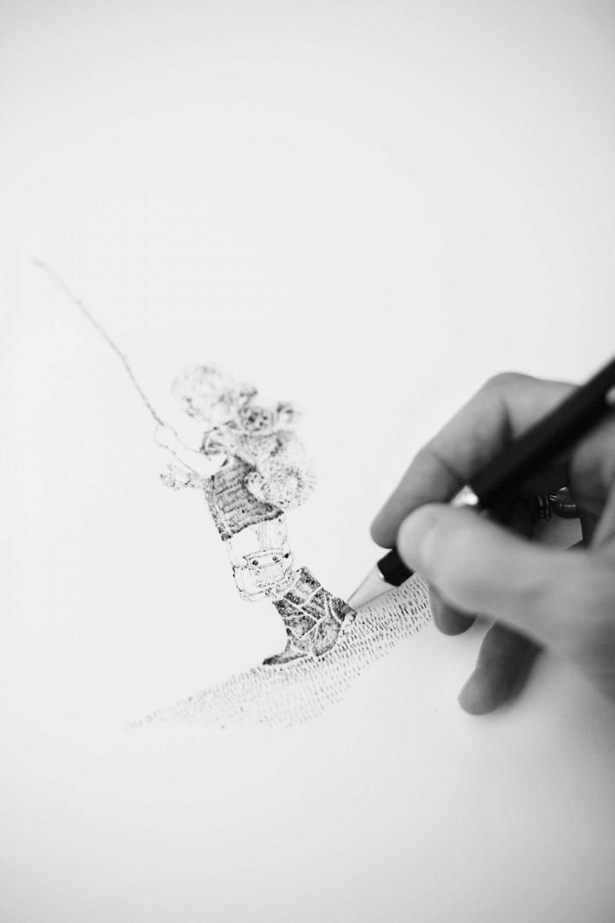 Kate drawing in her studio.