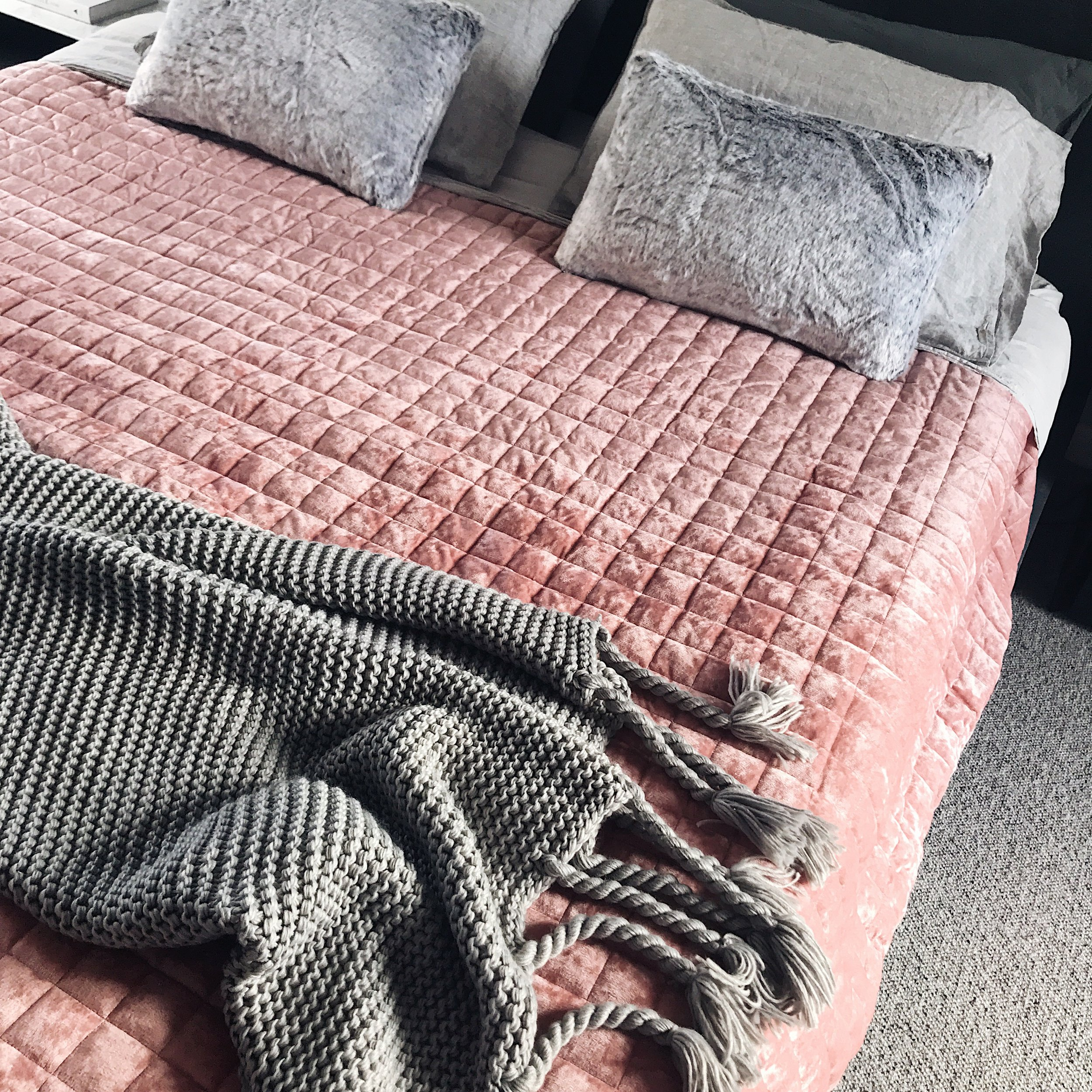 I've paired it back with European stonewash light grey sheets, charcoal pillow slips and Vintage washed linen pillow slips in grey to complete the look. I also LOVE the chunky tassle throw over the end of the bed  (here) , it adds such warmth to the space and the faux fur cuhsions  (here)