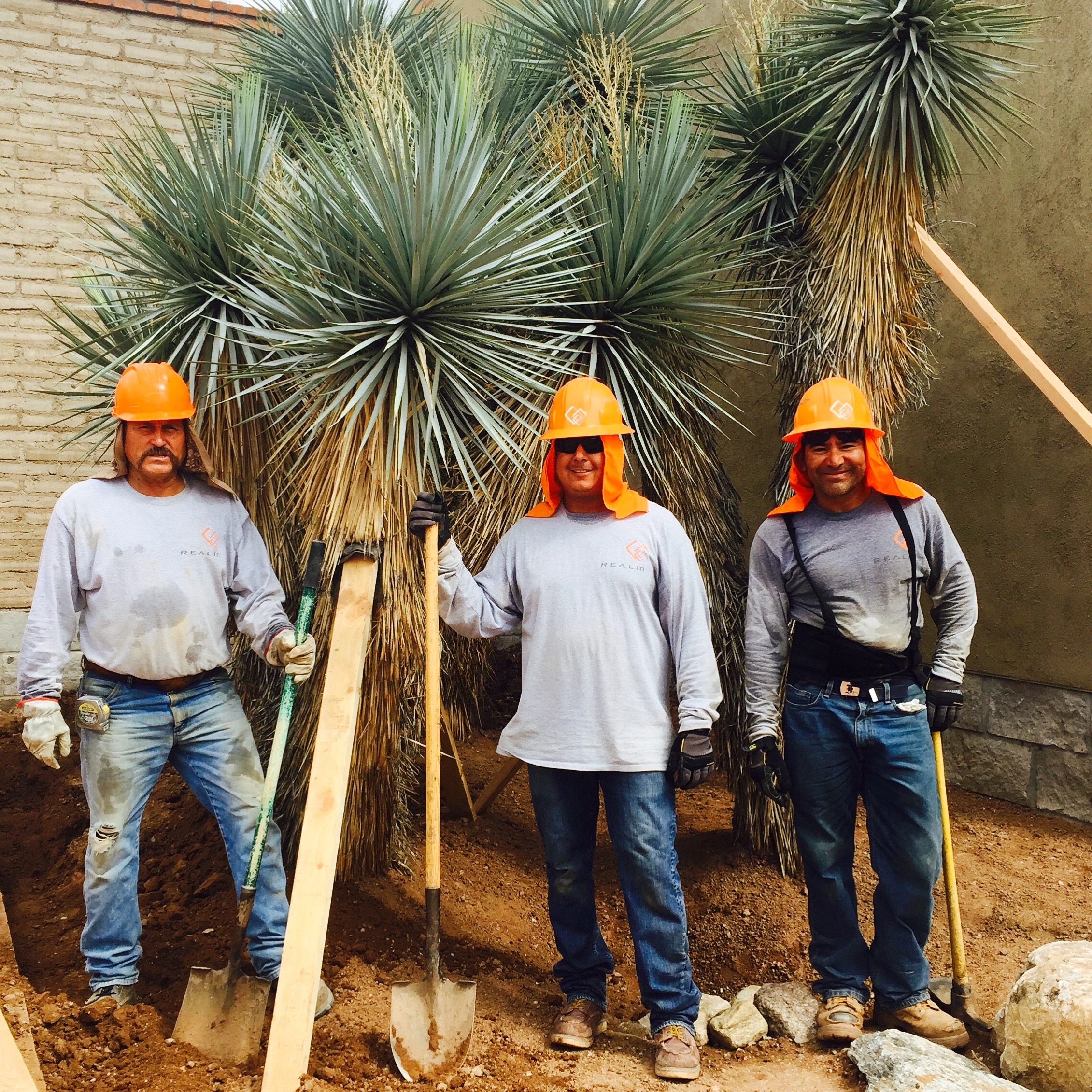 Members of Team REALM pose w/ newly-installed Yuccas at TBG
