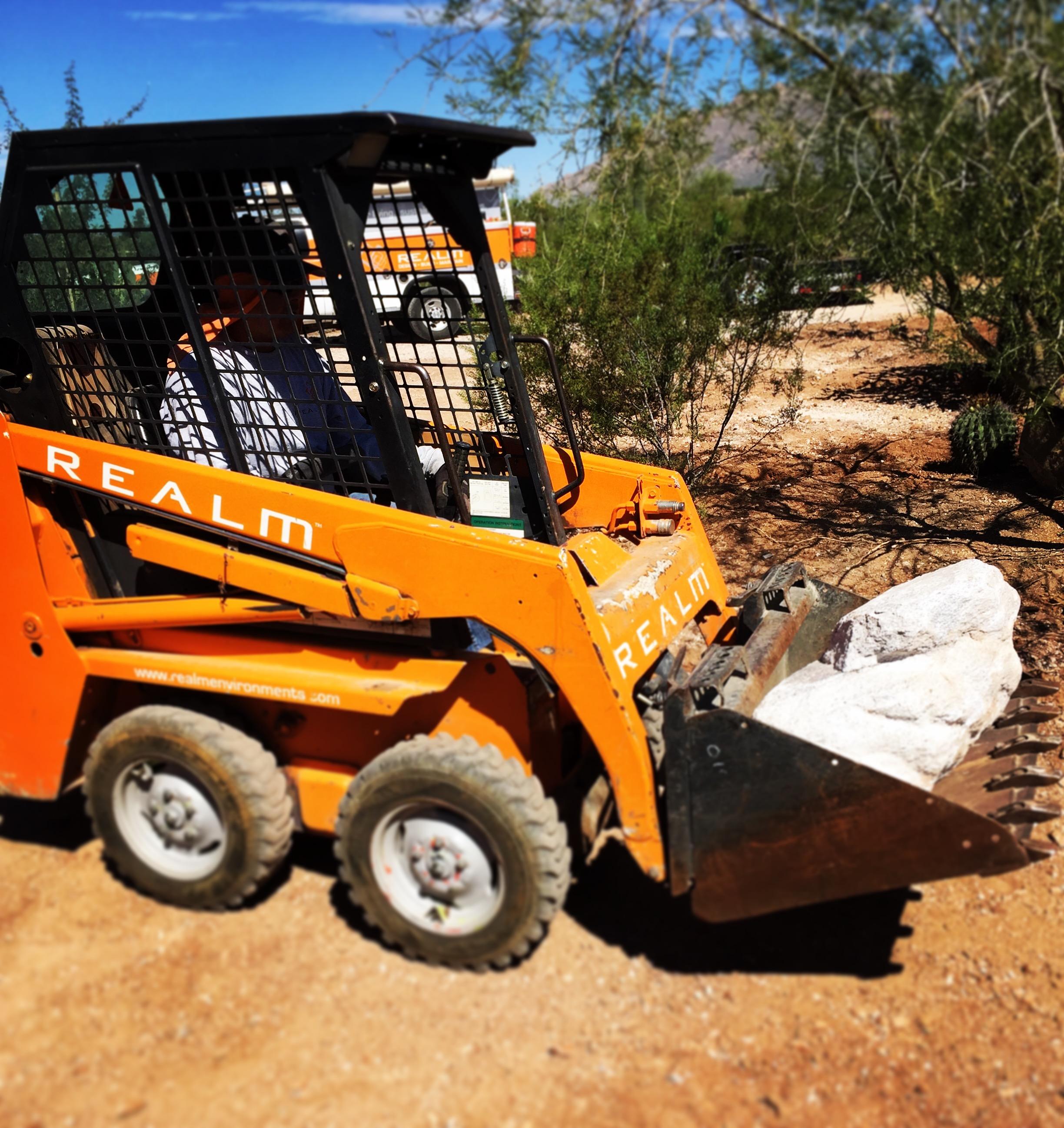 Native boulder relocation and rainwater harvesting gradework