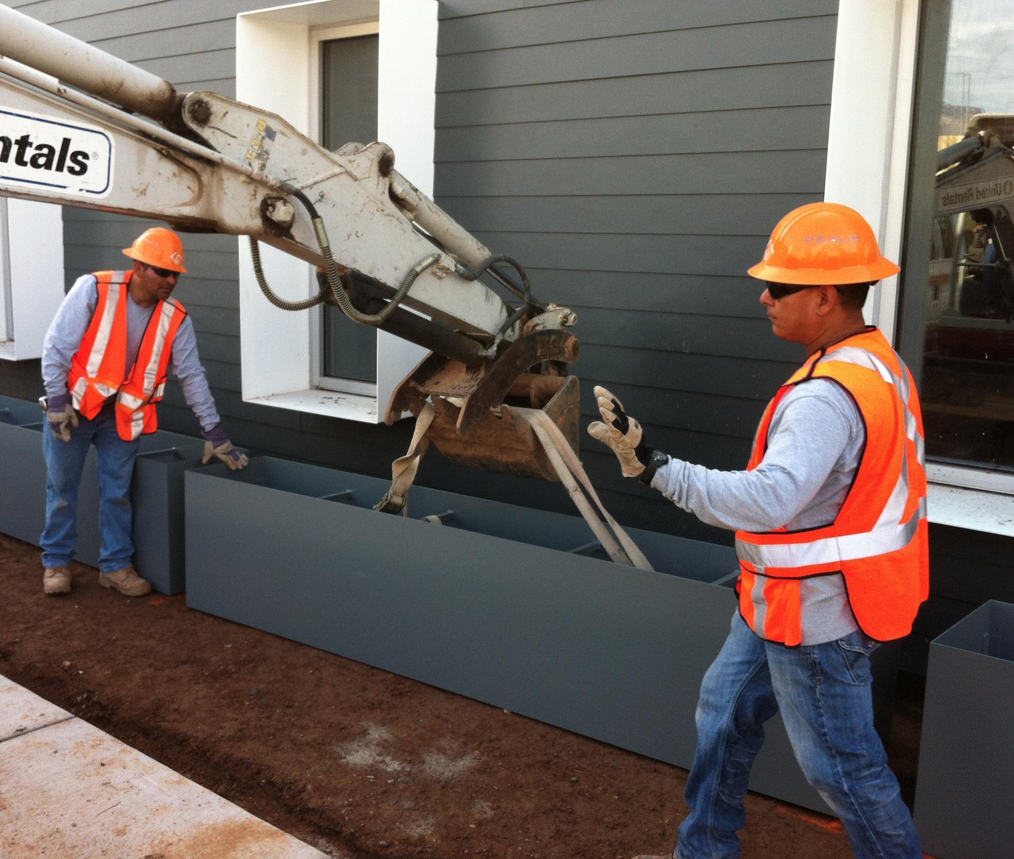 Installing custom fabricated metal planters at Habitat for Humanity HQ