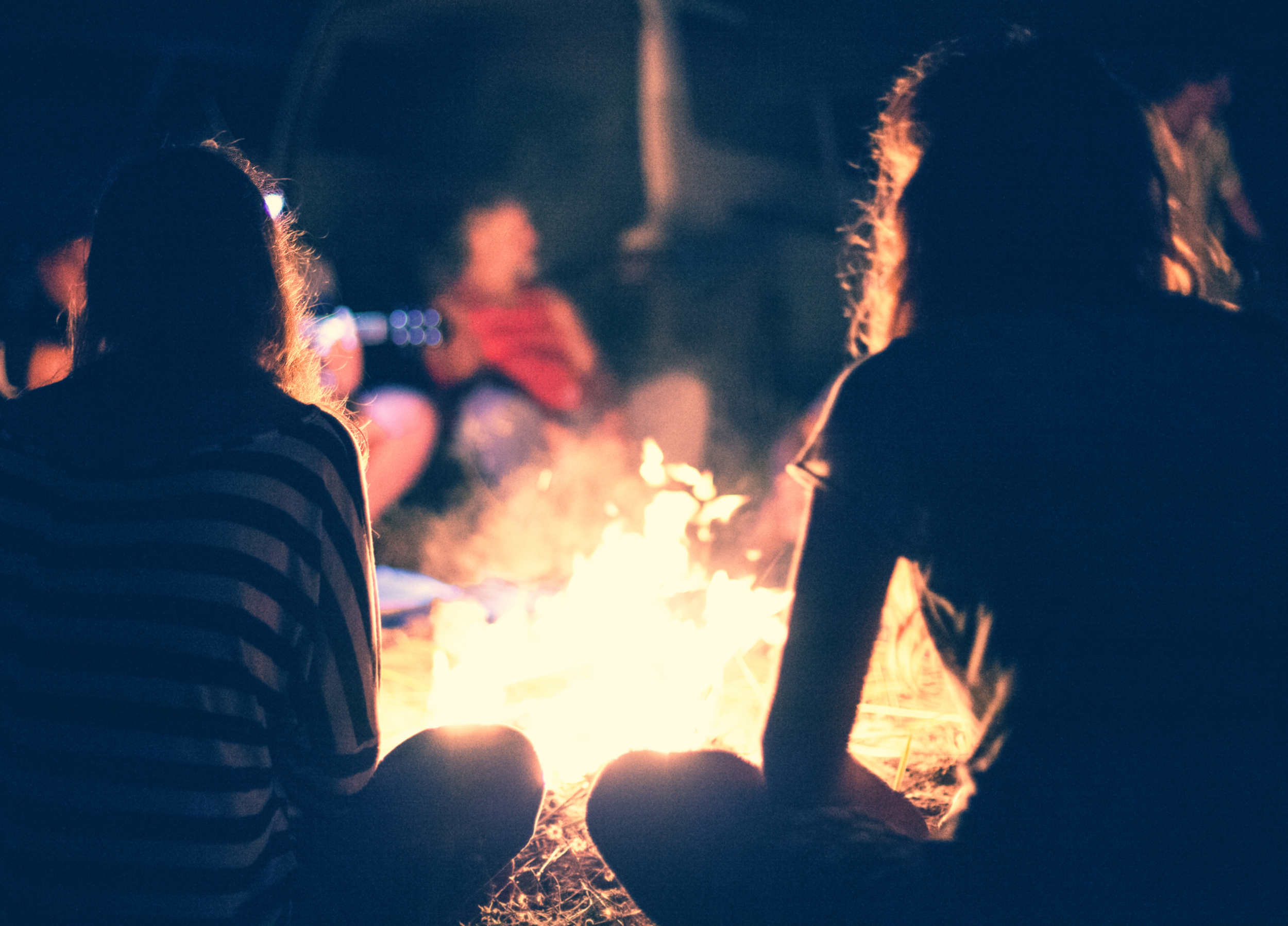 stock-photo-people-sit-at-night-round-a-bright-bonfire-211091626.jpg