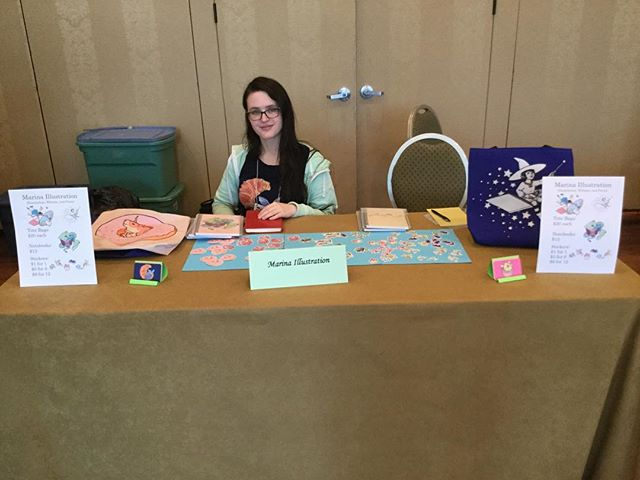 Last Friday, I had my first experience selling items with my art at my own table! I painted a design for the NY YSS Conference, so I got a table to sell things/promote my work on top of my commission. I was terrified to do this event, but I'm glad that I did it in the end. My sister helped a lot with setting up and manning the table, and she took this photo at the end of the day. 😊 #artistsoninstagram #illustration