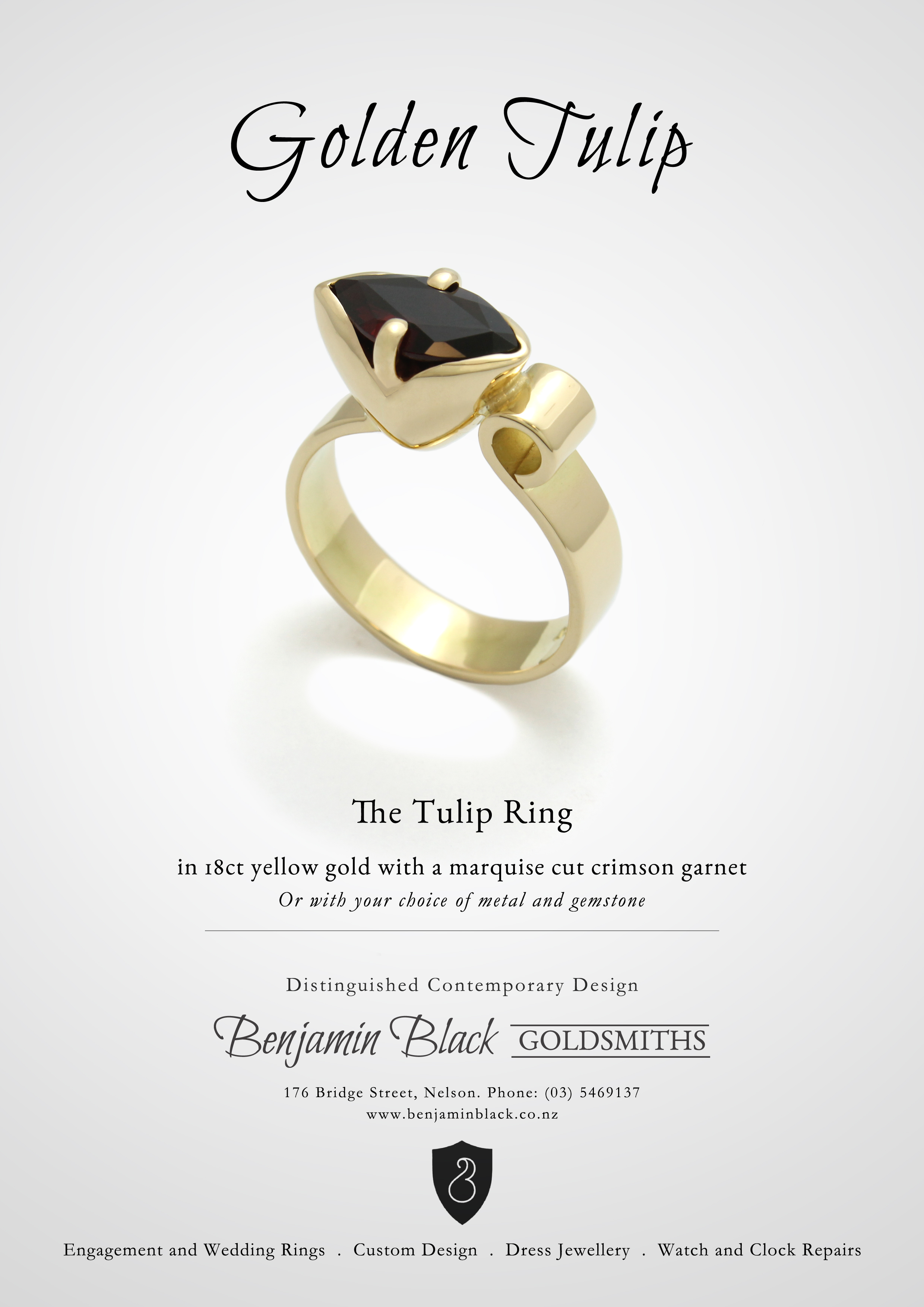 Gold tulip ring garnet.jpg