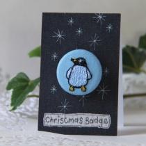 penguin-chrstmas-badge-by-poppy-treffry-ls.jpg