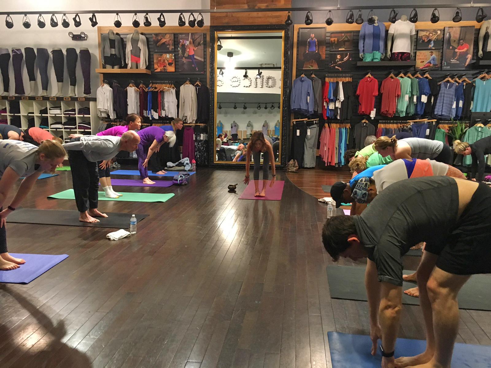 Libby McAvoy teaching yoga at Lululemon Athletica