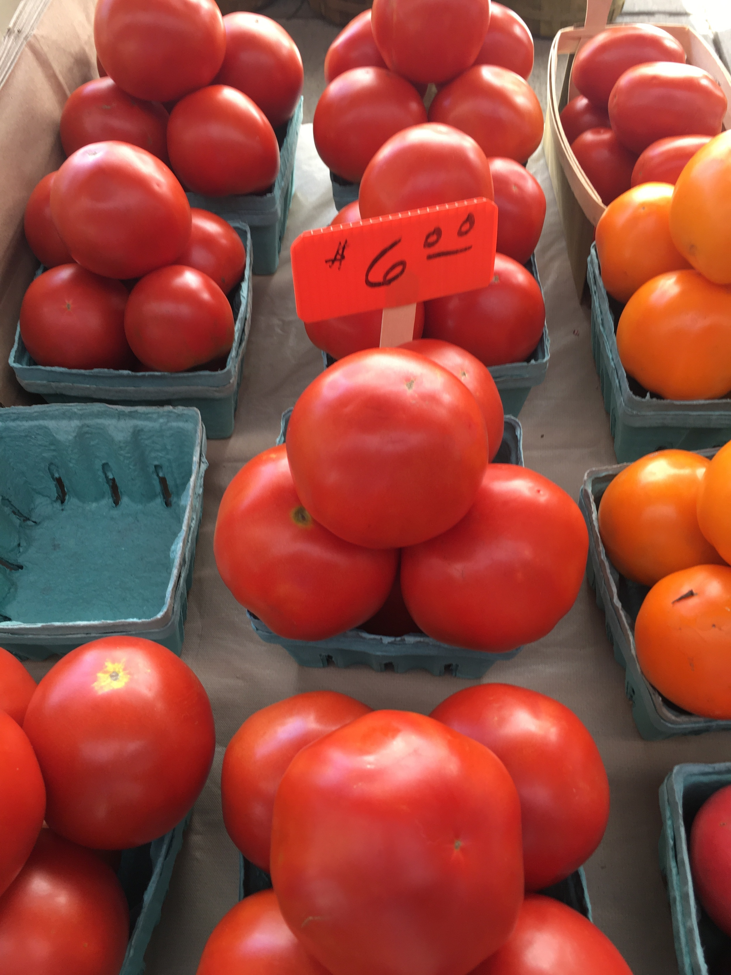 Nothing beats a fresh summer tomato.  There are many types of tomatoes so again, talk to the farmers and they can direct you if you do not know which kind you want.