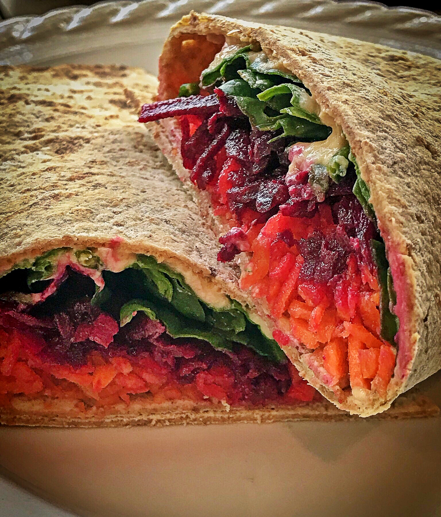 Pre shredded beets and carrots make hummus wraps fast, easy, and delicious.
