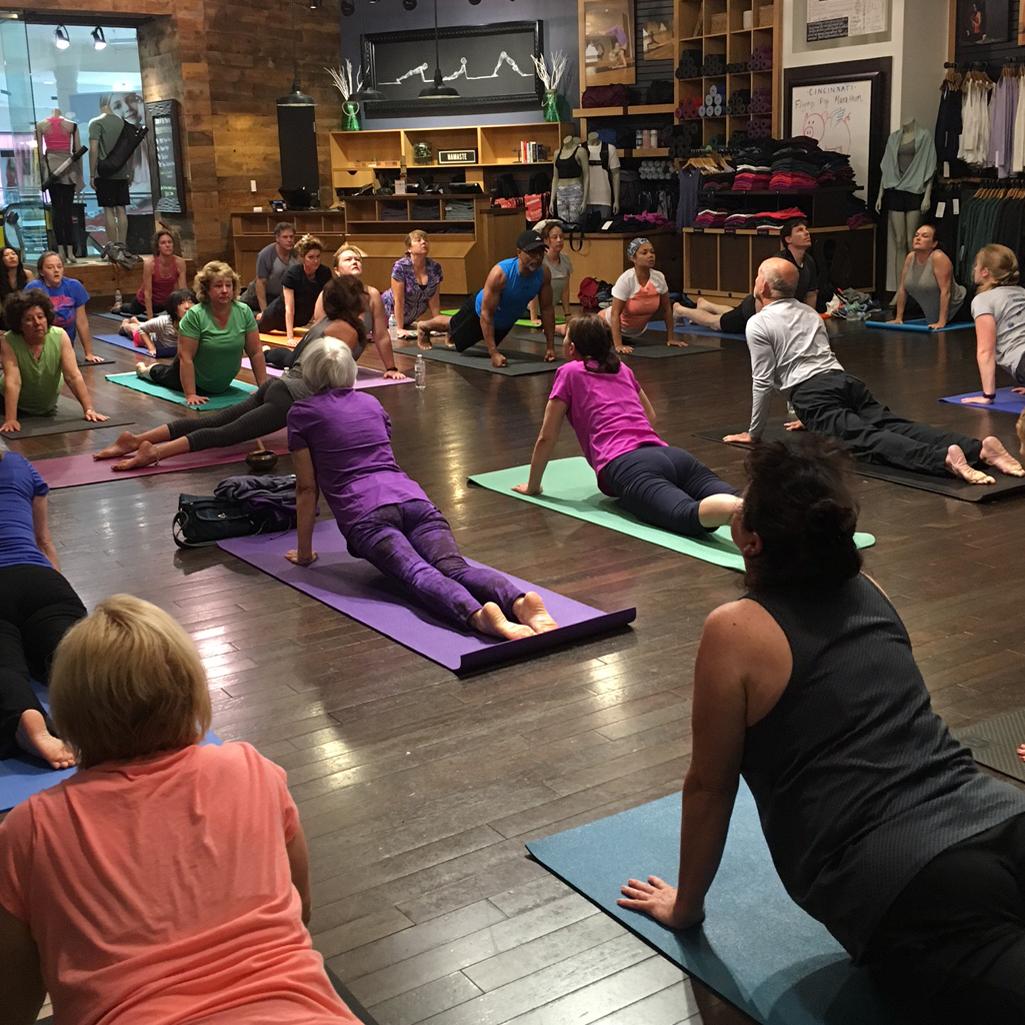 Leading a yoga class for Lululemon Athletica.