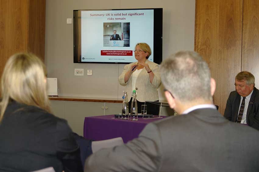 Juliette Healey presenting the Bank's outlook