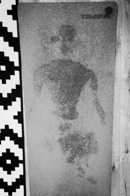 Proof that mermaids exist? This crime scene outline was left behind on my mat after Sarah's super sweaty hot class. You be the judge.