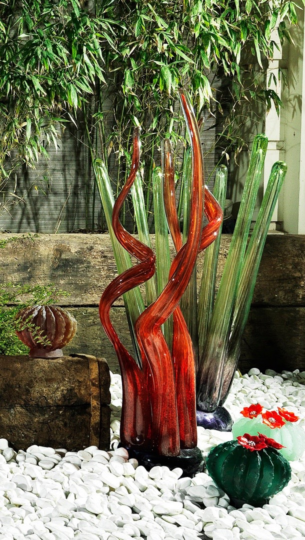 Hot formed sculptures in red and lime green circa 90 cm and casted cacti emerald green, celadon green and amber