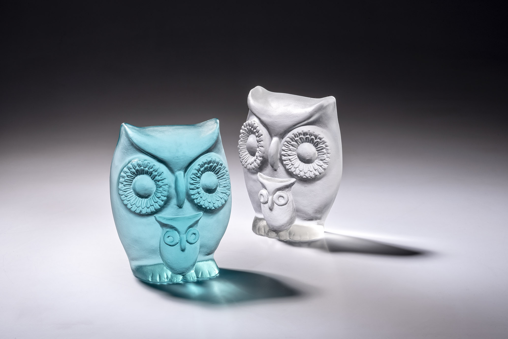 Owl with her baby in turquoise blue and clear casted glass