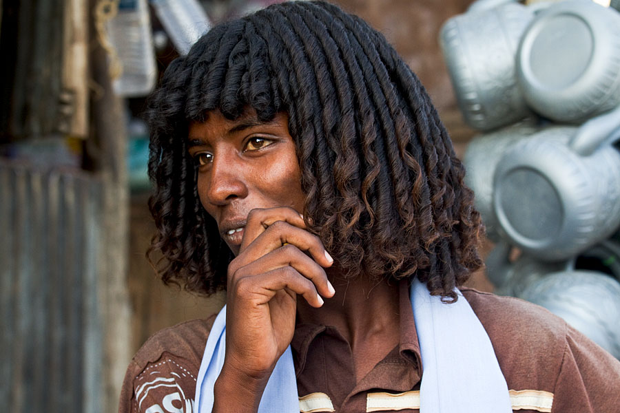 But can we?     yagazieemezi :     CLASS, CAN WE TAKE A MINUTE, AN HOUR OR SOMETHING TO DISCUSS BROTHER'S HAIR?!?    Johan Gerrits. Afar boy at the market of Assaita - Ethiopia.