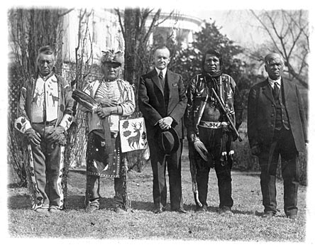 Commissioner of Indian Affairs John Collier meets with South Dakota Blackfoot Indian chiefs in 1934 to discuss the Wheeler-Howard Act. The Act, later known as the Indian Reorganization Act, allowed for Native American self-government on  A tribal basis.