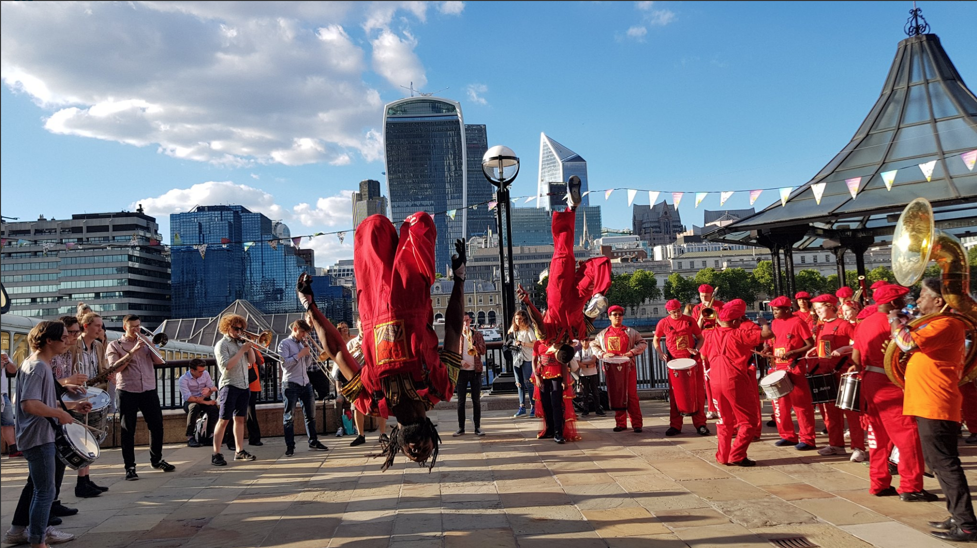 "Kinetika Bloco youth group and the Voodoo Brass Band of London in the NOLA Fest / Make Music Day UK ""2018 New Orleans Tricentennial Parade"" in Central London."