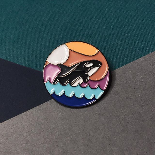 We've been sketching away at new orca pin designs, but aren't ready to share just yet! As for now, we have less than 20 of these beautiful orca pins we made with @atomicchilddesign! Thinking about retiring it.. what do y'all think?