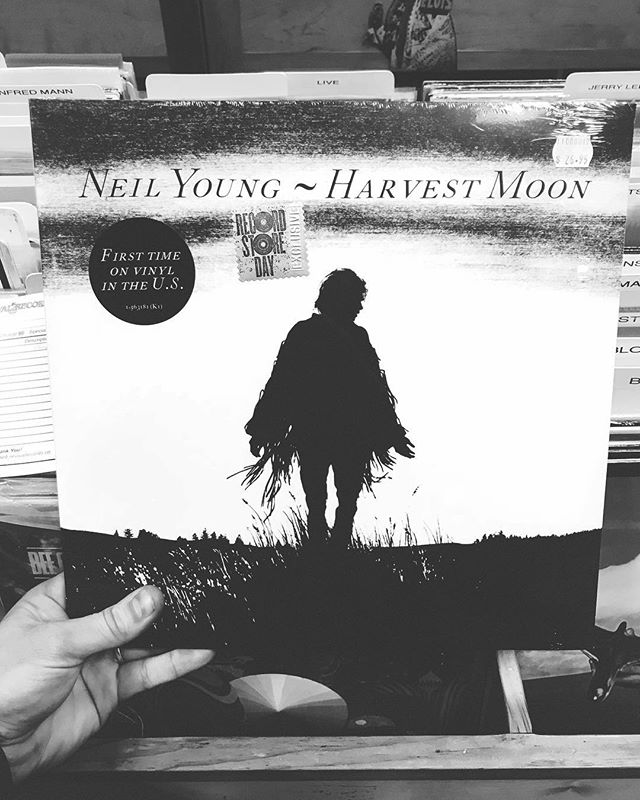 For at least a year, every time I'd go into a record store, I'd always check the Neil Young section to try to find a copy of Harvest Moon - always to no avail. I FINALLY found a copy at @revival_records last weekend and also found out that the reason I could never find one apparently was because it had never been printed on vinyl in the US until now. Over the (harvest) moon with excitement to finally own this piece of magic. Support your local record stores - they're vital.