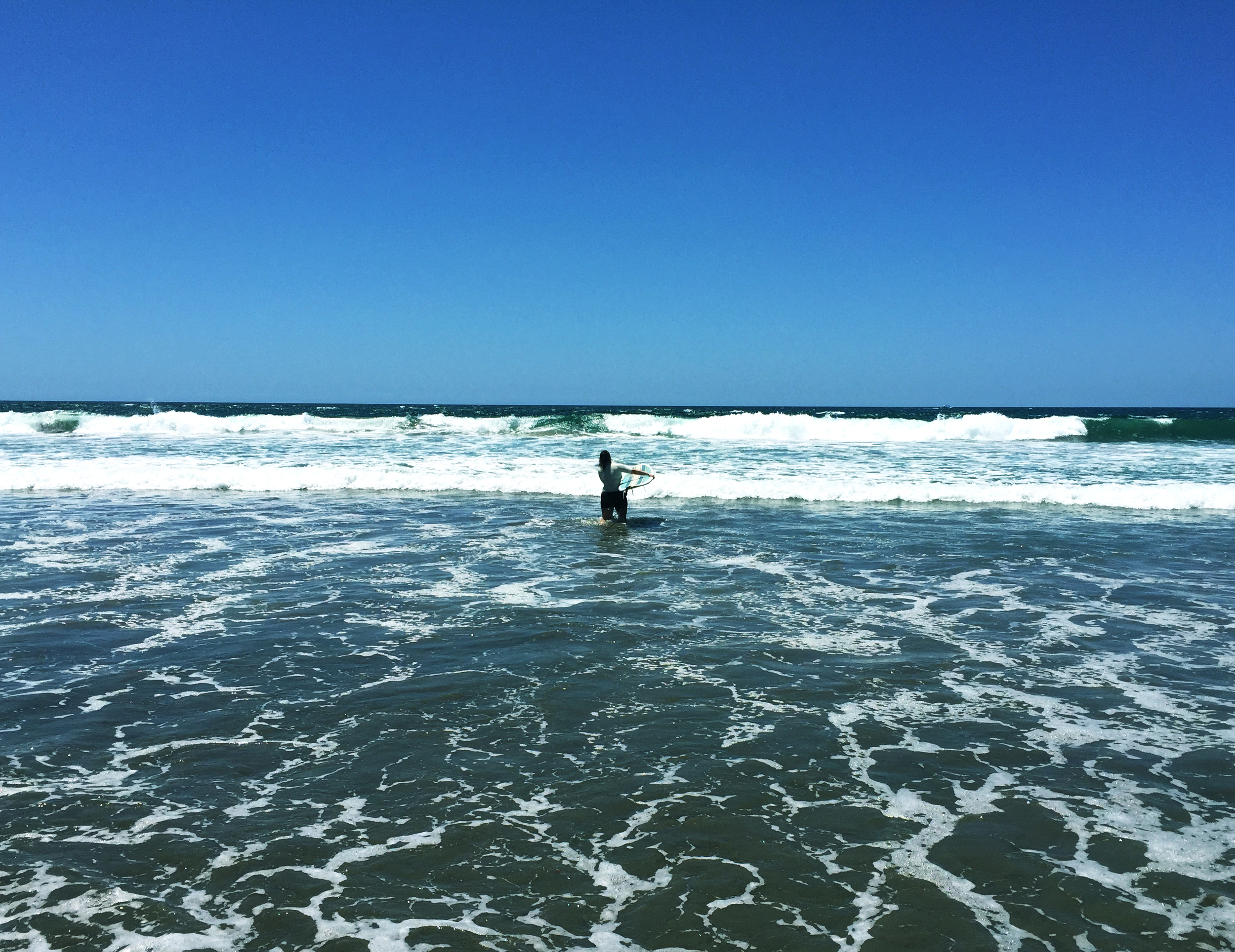 Surfing Playa Negra's Sandy beach