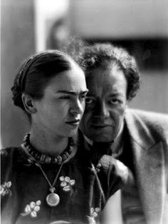 Frida Kahlo wearing a locket; pictured with Diego Rivera, photo by Martin Munkacsi, 1930.